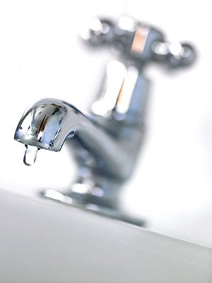 Dripping faucet to protect pipes from freezing