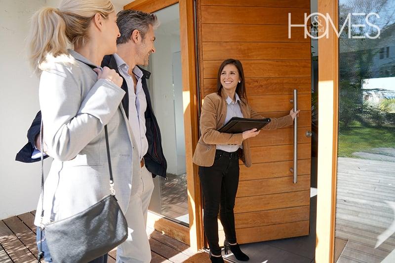 agent-opening-door-for-clients-1