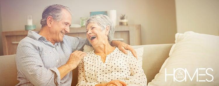 elderly-couple-warm-embrace-laughing-1