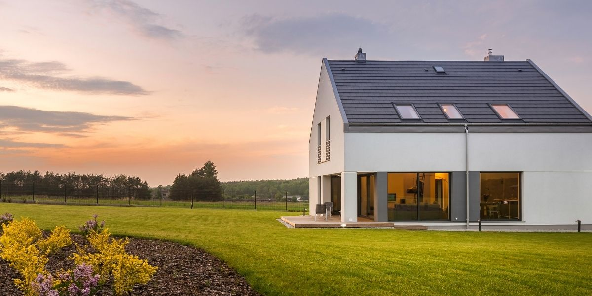 A beautiful sunset over a home for sale
