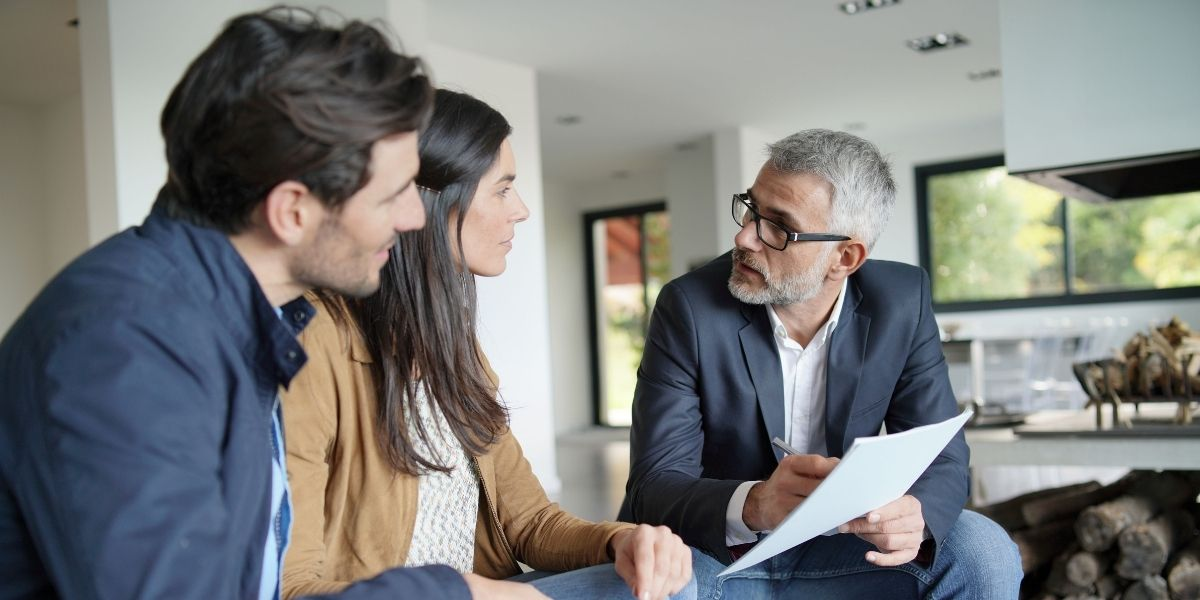 A realtor meeting with high-end real estate clients he attracted by applying these tips